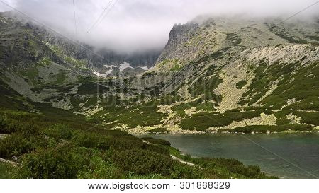 Rocky Lake Is A Moraine Lake In The Lowest Rock Of The Rocky Valley. High Tatras. Slovakia