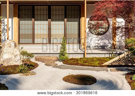 Traditional Japanese Courtyard With Rock Garden. Japanese Garden. Cozy Picturesque Japanese Garden.