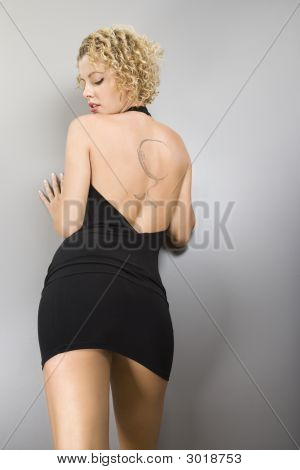 Woman With Back Tattoo.