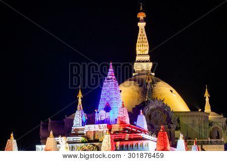 Architecture Of Wat Bunglatthiwan In Ayutthaya, Thailand On Vesak Day With Colour Light Decor Around