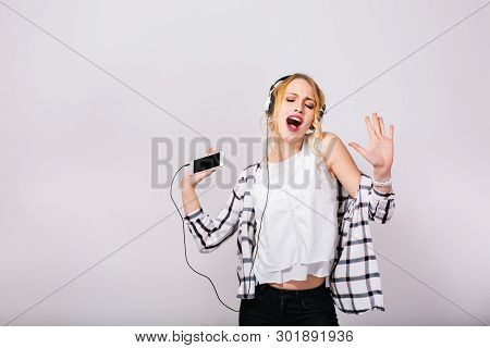 Lovely Cute Blonde Woman Enjoying Her Life, Singing And Dancing With Closed Eyes. Mirthful Smart Gir