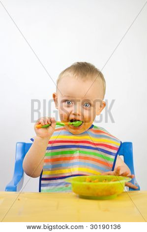 Infant Eating His First Meals