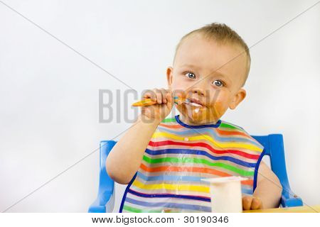 Messy Faced Infant Eating