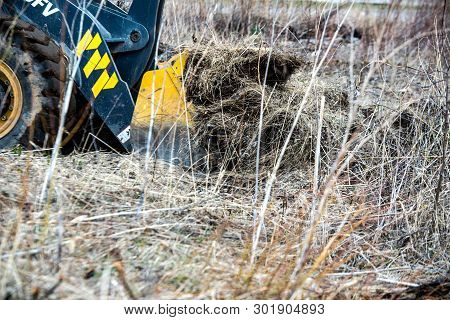 Chelyabinsk Region, Russia - May 2019: Bulldozer Pushes The Ground, Tractor Pushes A Lump Of Soil, P