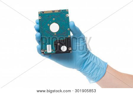 Hand In Latex Surgical Glove Hold Hard Disc, Isolated On A White Background. Hard Drive In Hand.