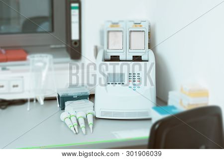 Part Of Modern Scientific Laboratory With Pcr Machine For Dna Amplification On Work Bench.