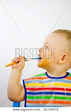 Cute Messy Infant Eating Side On