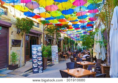 Nicosia, Cyprus - Oct 4th 2018: Outdoor Cafe With Amazing Colorful Umbrellas Decorating The Top Of T
