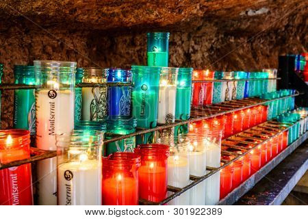 Montserrat, Spain, April 23, 2017: Prayer candles in Santa Maria de Montserrat monastery