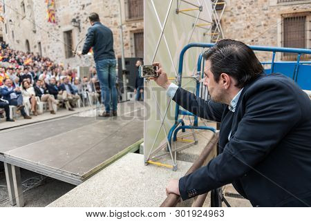 Caceres, Extremadura, Spain - May  18, 2019:  A Man Takes A Photograph Of The Intervention Of The Le
