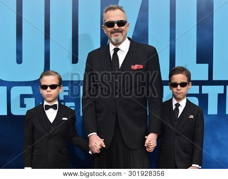 LOS ANGELES - MAY 18:  Miguel Bose Diego Bose and Tadeo Bose arrives for the 'Godzilla: King of the Monstersl' Hollywood Premiere on May 18, 2019 in Hollywood, CA