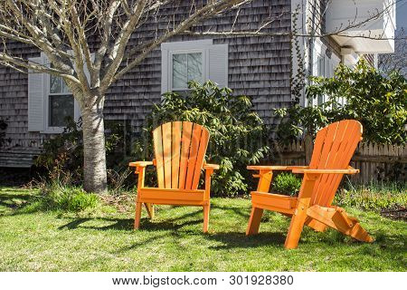 Adirondack Beach Chair Near The House With Grass In Provincetown (cape Cod). Concept Of Perfect Calm