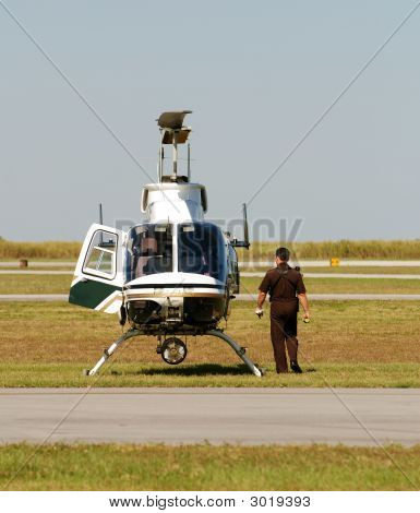 Police helicopter pilot preparing for emergency takeoff poster