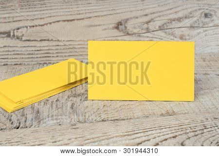 Blank Golden Business Cards On The Wooden Table. Template For Id. Top View.