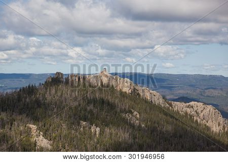 An Aerial View Of Black Elk Peak ( Formerly Harney Peak) And Tower Which Overlooks Eroded Rock Forma
