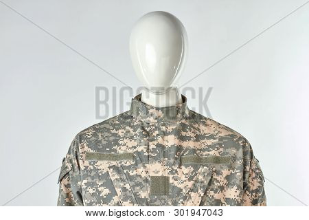 Portrait Of Mannequin In Military Soldiers Uniform. White Isolated Background.