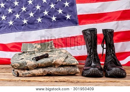 Army Military Outfit With Us Flag Background. Soldier Uniform With Flag Of The United States.
