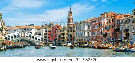 Rialto Bridge Over Grand Canal, Venice, Italy. It Is A Famous Landmark Of Venice. Panorama Of The Ol