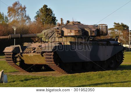 Military Tank In The Green Field. Panzer Tank.