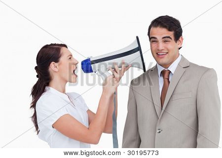 Saleswoman with megaphone yelling at colleague against a white background