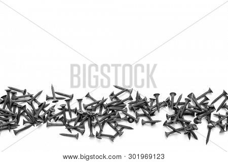Black drywall screws for plasterboard on white background