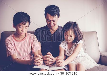 Multicultural Asian Children Praying With Their Father At Home, Family Pray