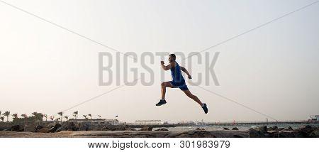Run Hard Or Walk Home. Running Man On Beach. Runner Training Outdoors. Fit Male Sport Fitness Exerci