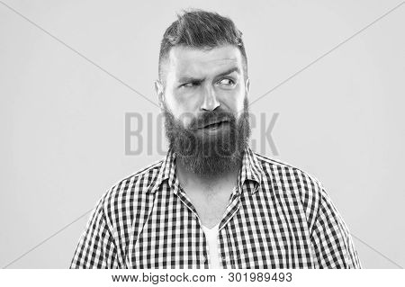Sounds Tricky. Man Serious Face Raising Eyebrow Not Confident. Have Some Doubts. Hipster Bearded Fac