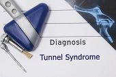 Neurological diagnosis of Tunnel syndrome. Neurologist directory, where is printed diagnosis Tunnel syndrome, lies on workplace with MRI image and neurological diagnostic tools close up poster