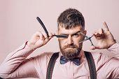 Hairdresser at barber shop. Man visiting hairstylist in barbershop. Bearded man in barbershop. Work in the barber shop. Man hairstylist. poster
