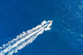 Boat Launch At High Speed Floats In The Mediterranean, Aerial Top View