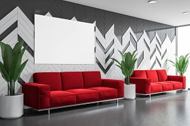 Red Sofas In Waiting Room Interior With Poster