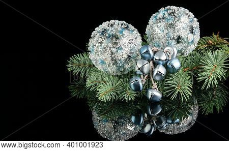 Silver, Blue And White Christmas And New Year Balls, Baubles And A Branch Of Natural Blue Fir On The