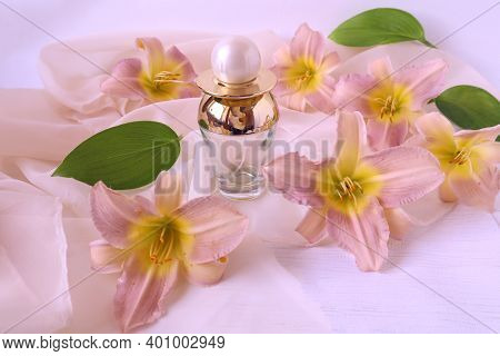 Pink Daylily Flowers With A Bottle Of Eau De Toilette, Side View, Close-up