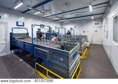Gubkin, Russia - June 12, 2020: Manual Waste Bulkhead. Waste Sorting Plant Conveyors Filled With Var