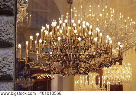 Expensive Luxury Large Chandelier Behind Glass With Gilding. Reflection In The Shop Window. Lights I