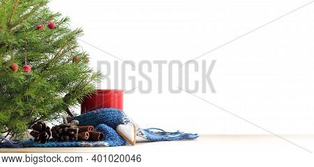 Red Mug With Blue Scarf Under The Christmas Tree. Warming Atmosphere With Space For Wishes