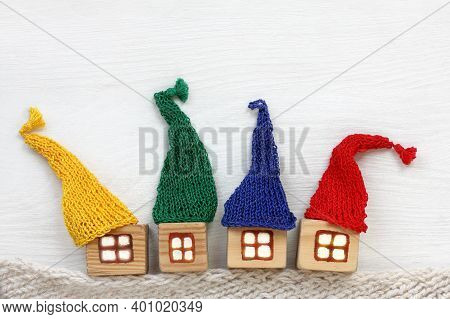 Four Houses In Colorful Hats. Warming Offers For Every Taste