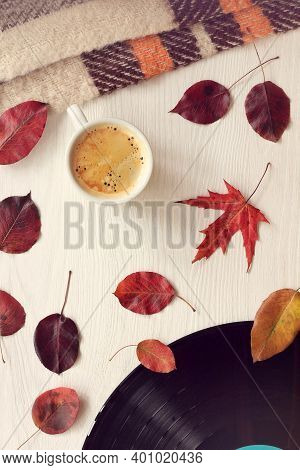 Espresso Cup With Autumn Leaves Plaid And Vinyl Record On The Table Top View. Espresso Cup With Autu