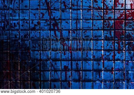 Bloody Background. The Dirty Tile Wall Is Stained With Blood. A Gloomy Morgue Room With A Blue Light