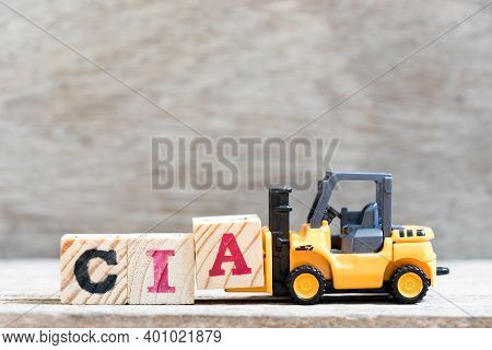Toy Forklift Hold Letter Block A In Word Cia (abbreviation Of Certified Internal Auditor) On Wood Ba