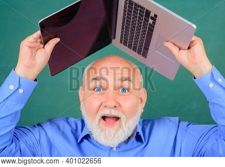 Old Man With Laptop. Bearded Man Holds Laptop. Digital Device. Serious Bearded Man With Laptop. Work