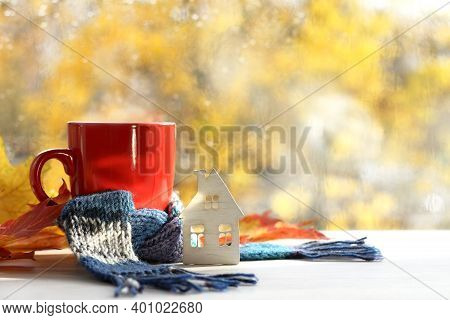 House Scarf And Mug With A Drink On The Background Of The Window After The Rain. Warming Home Autumn