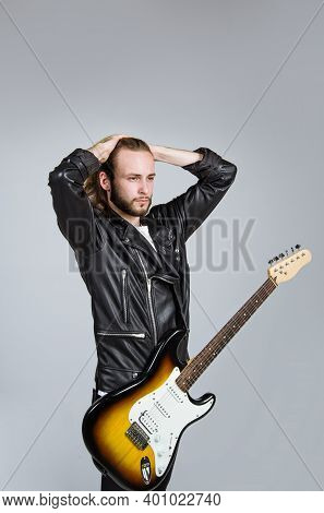 Rock Music. Handsome Bearded Man With Guitar. Electric Guitar. Man With Guitar. Brutal Man With Elec