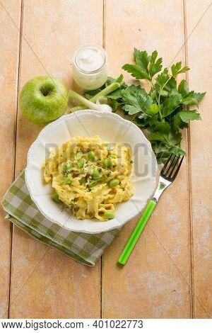 pasta wtih edamame apple cream sauce and parmesan cheese
