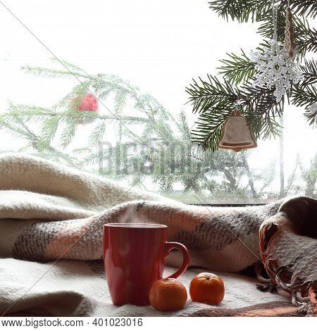 Mug And Tangerines With A Plaid On The Background Of A Winter Window. Waiting For