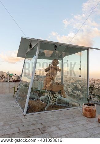 Bethlehem, Israel, December 09, 2020 : Large Statue Of The Child Of God In A Glass Showcase On The R