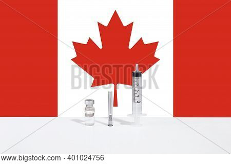 Flag Of Canada Illustrating Campaign For Global Vaccination Against Covid-19. Epidemic Virus