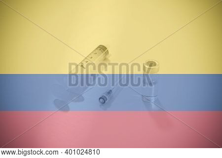 Flag Of Colombia Illustrating Campaign For Global Vaccination Against Covid-19. Epidemic Virus