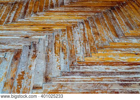 Old Worn Parquet With Peeling Varnish And Paint. Old Heavily Worn Wooden Floor